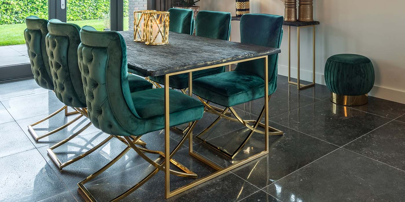 black dining table with gold legs