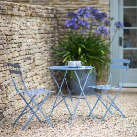 Small Round Table and 2 Chairs Bistro Set in Blue in small garden with flowers