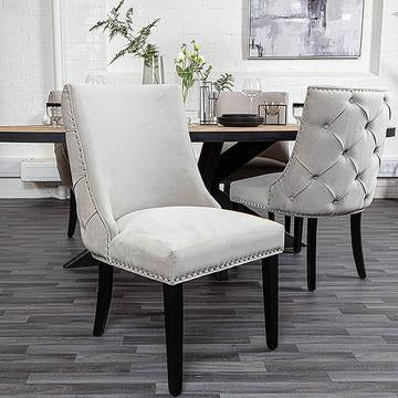 Cream velvet dining chair with button back detail