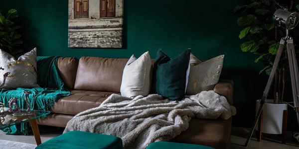 Brown Leather Sofa in Living Room with Dark Green Walls