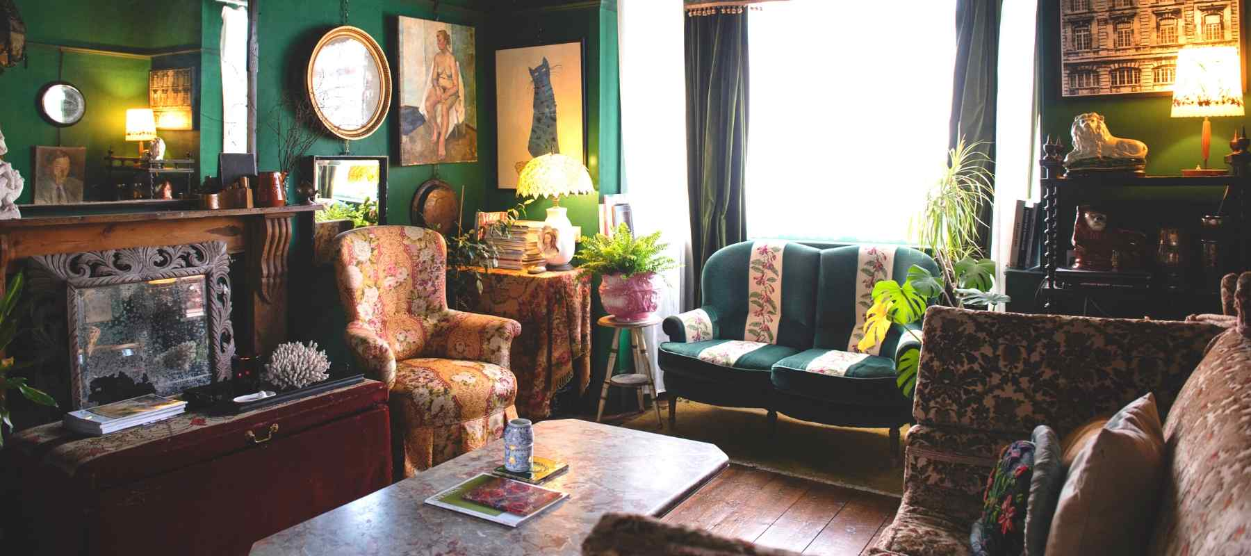Green lounge decorated with vintage wooden furniture