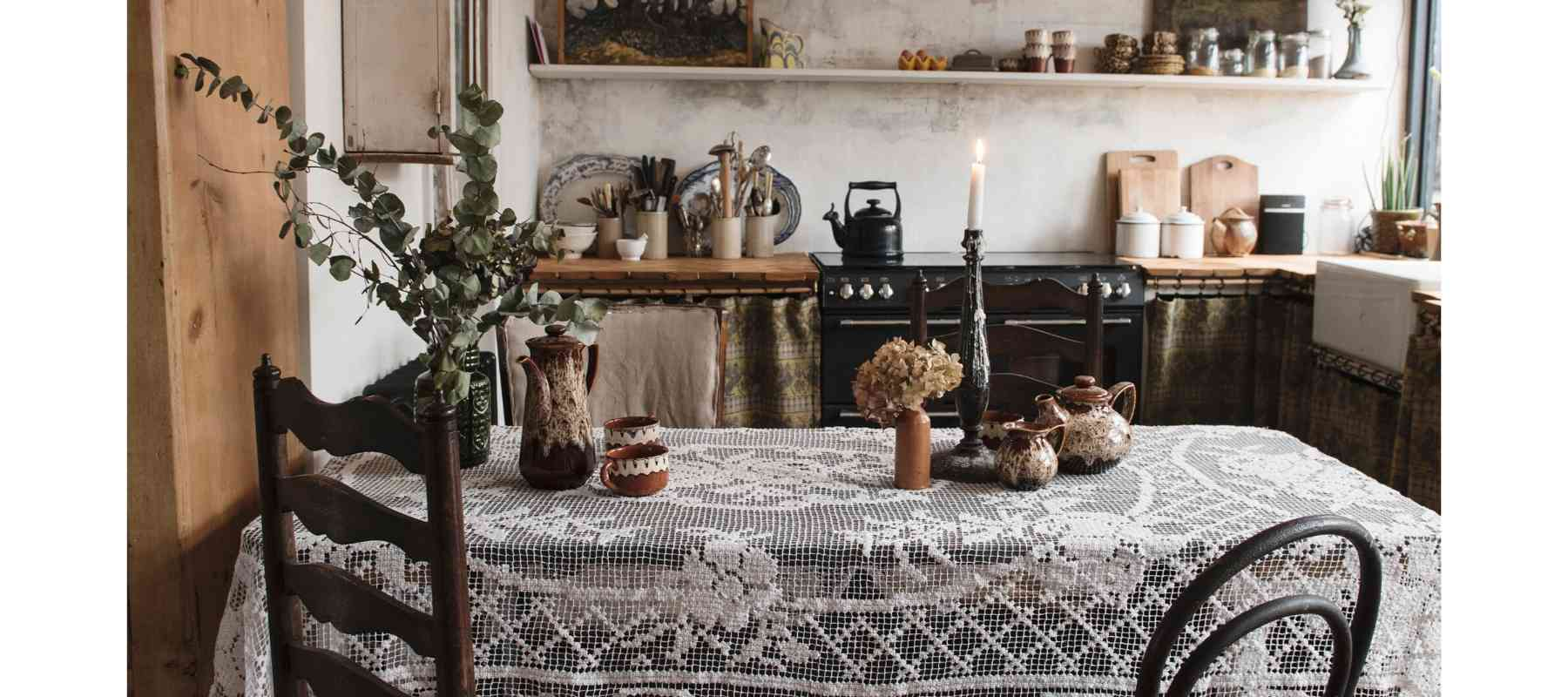 Wooden kitchen table with lace tablecloth