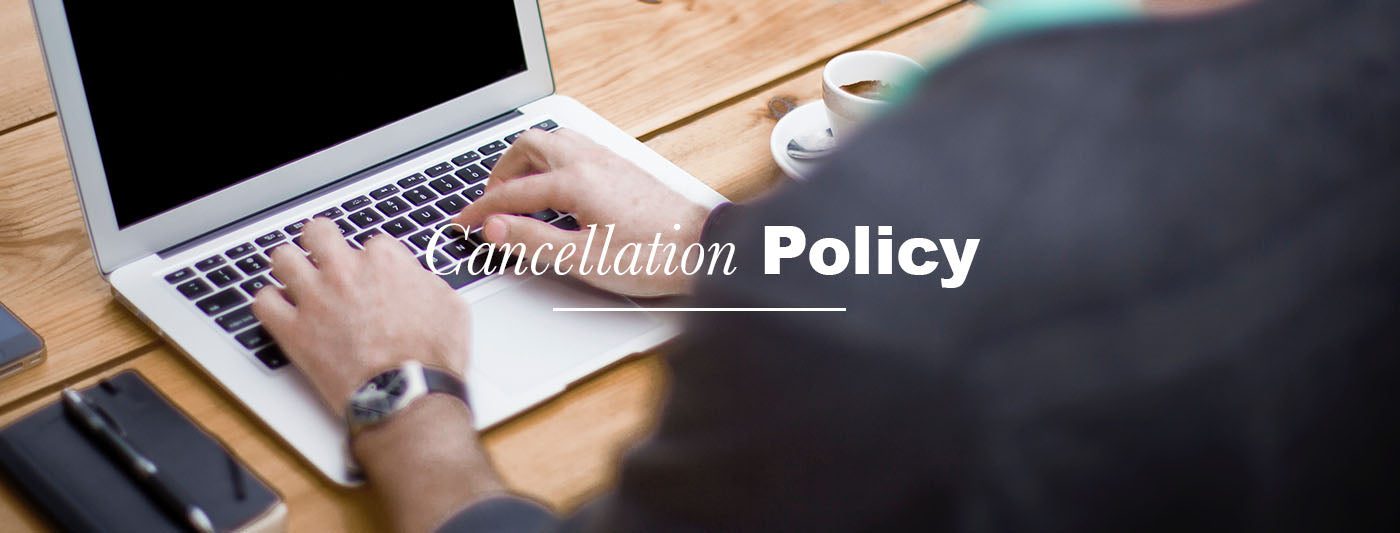 Cancellation Policy Man at Reclaimed Wood Desk