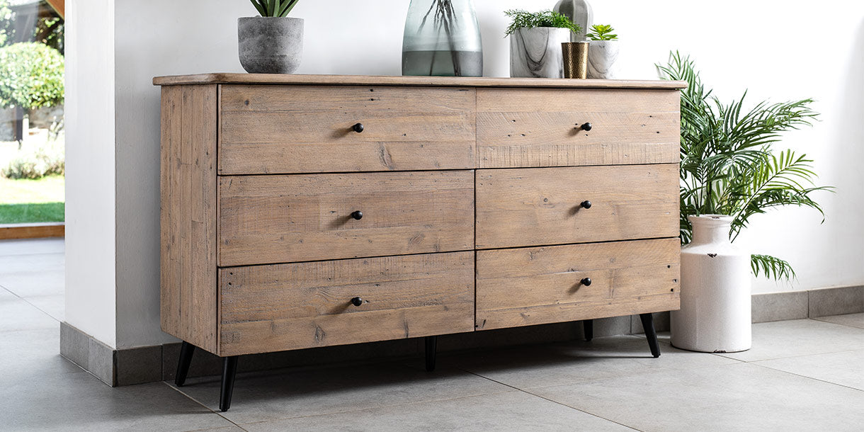 Chelwood large reclaimed wood chest of drawers in home