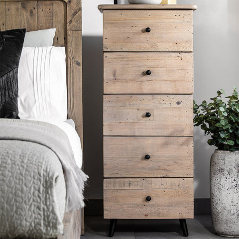 Tall bedside table in reclaimed wood next to matching bed