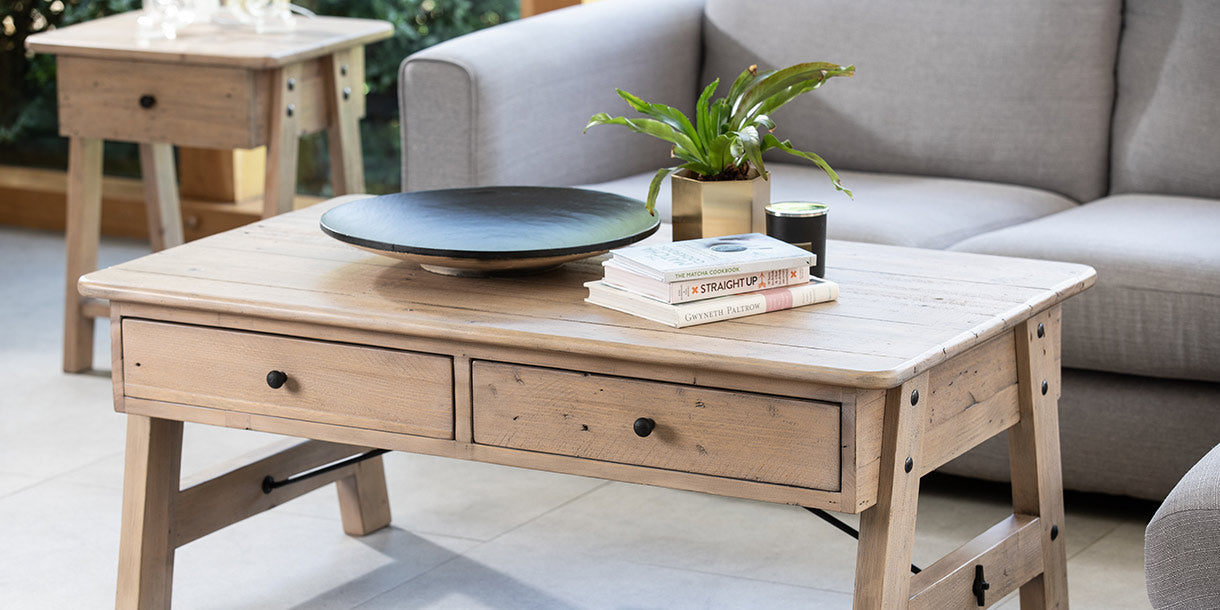 Living Room featuring Chelwood Reclaimed Wood Furniture including a coffee table with drawers