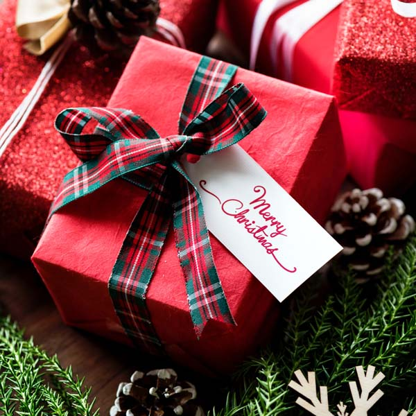 Christmas Gifts in Red Wrapping Paper