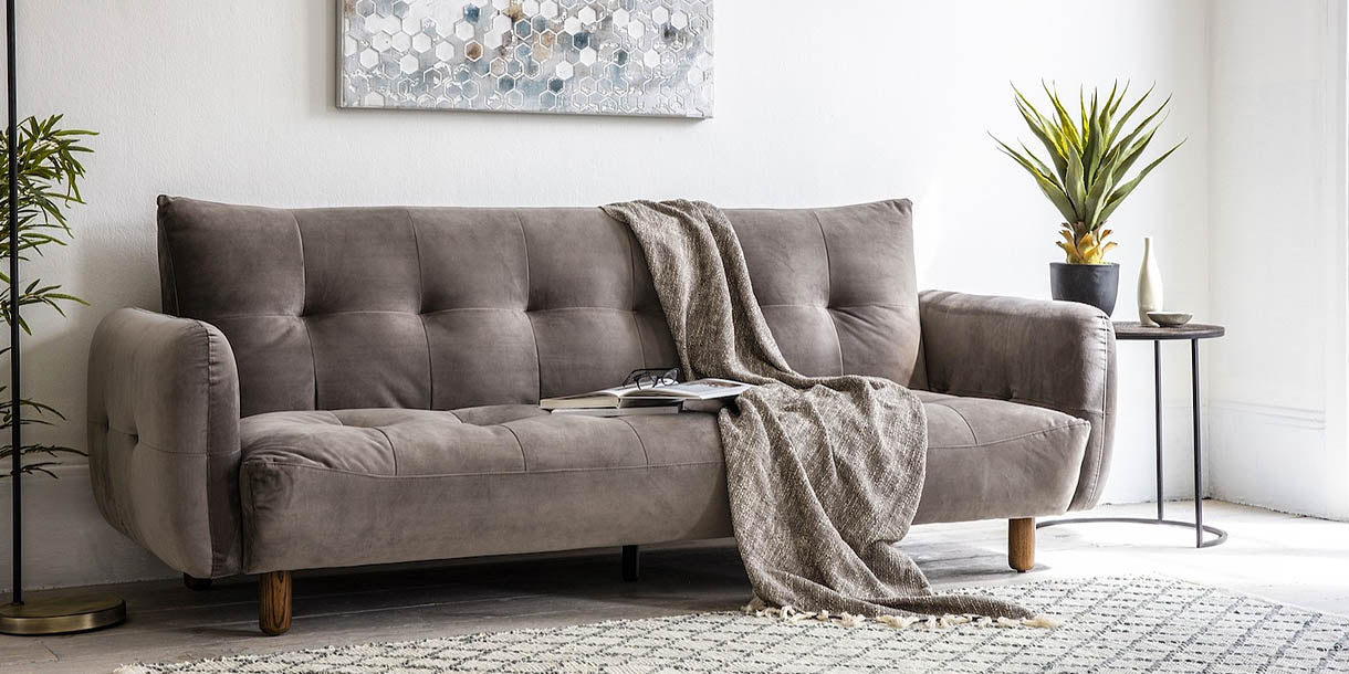 Compton Velvet Sofa Bed in room