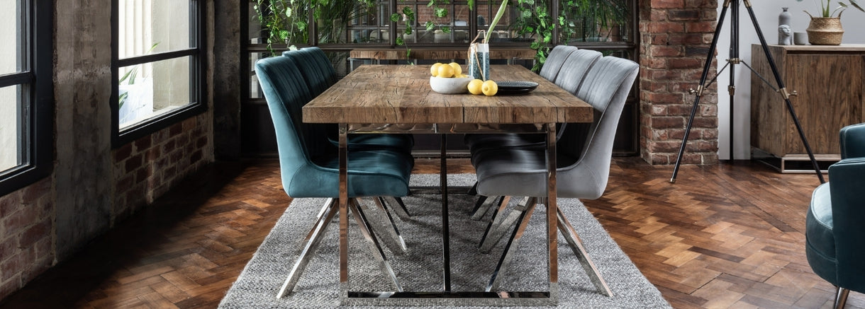 An overflowing fruit bowl sits on the Cotswold Reclaimed Oak Dining Table, surrounded by 6 empty chairs