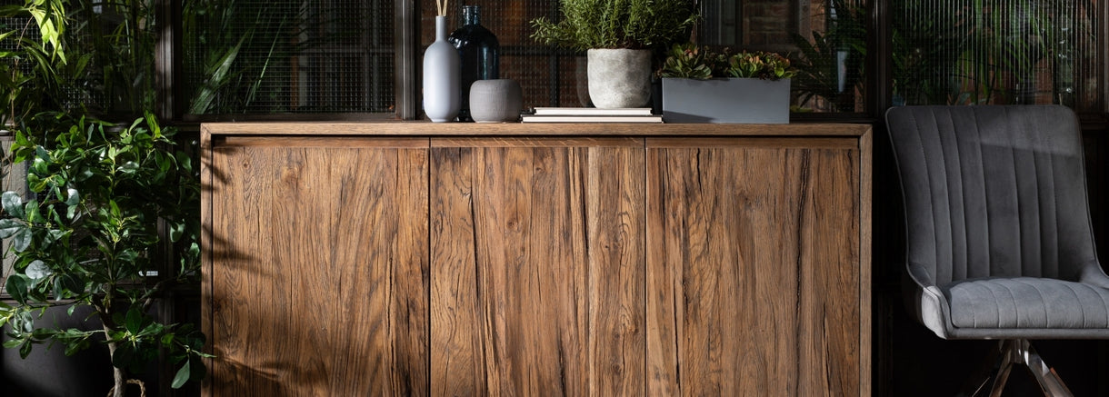 Plants and oddments atop the Cotswold Medium Reclaimed Oak Sideboard