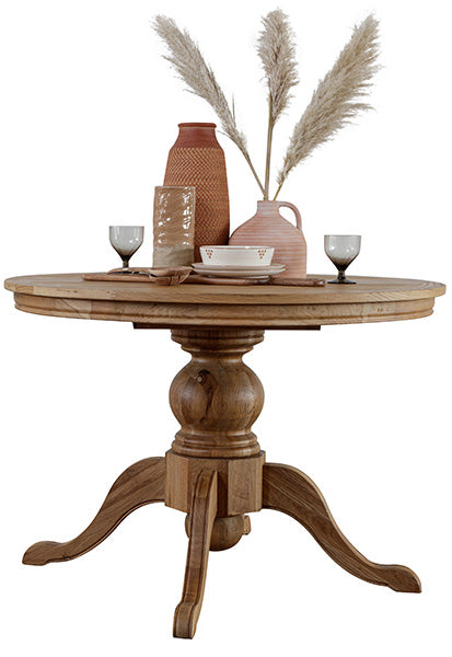 Extendable round wood dining table in a warm finish with earthy decorative items on top