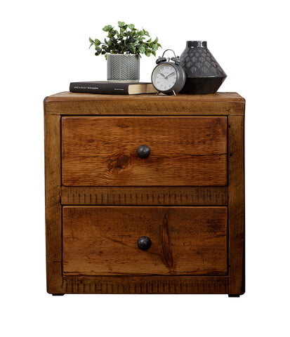 Dark wood bedside table with two drawers and decorative items