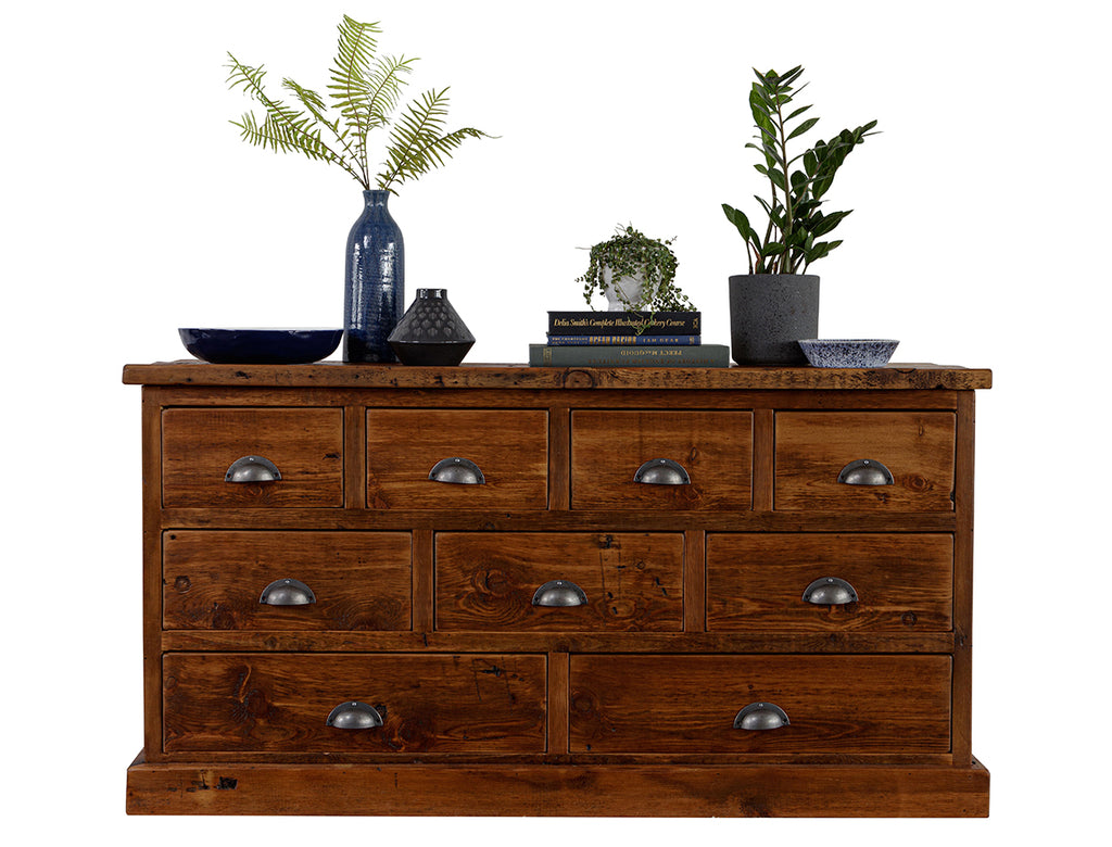 Dark brown chest of drawers with metal handles and decor