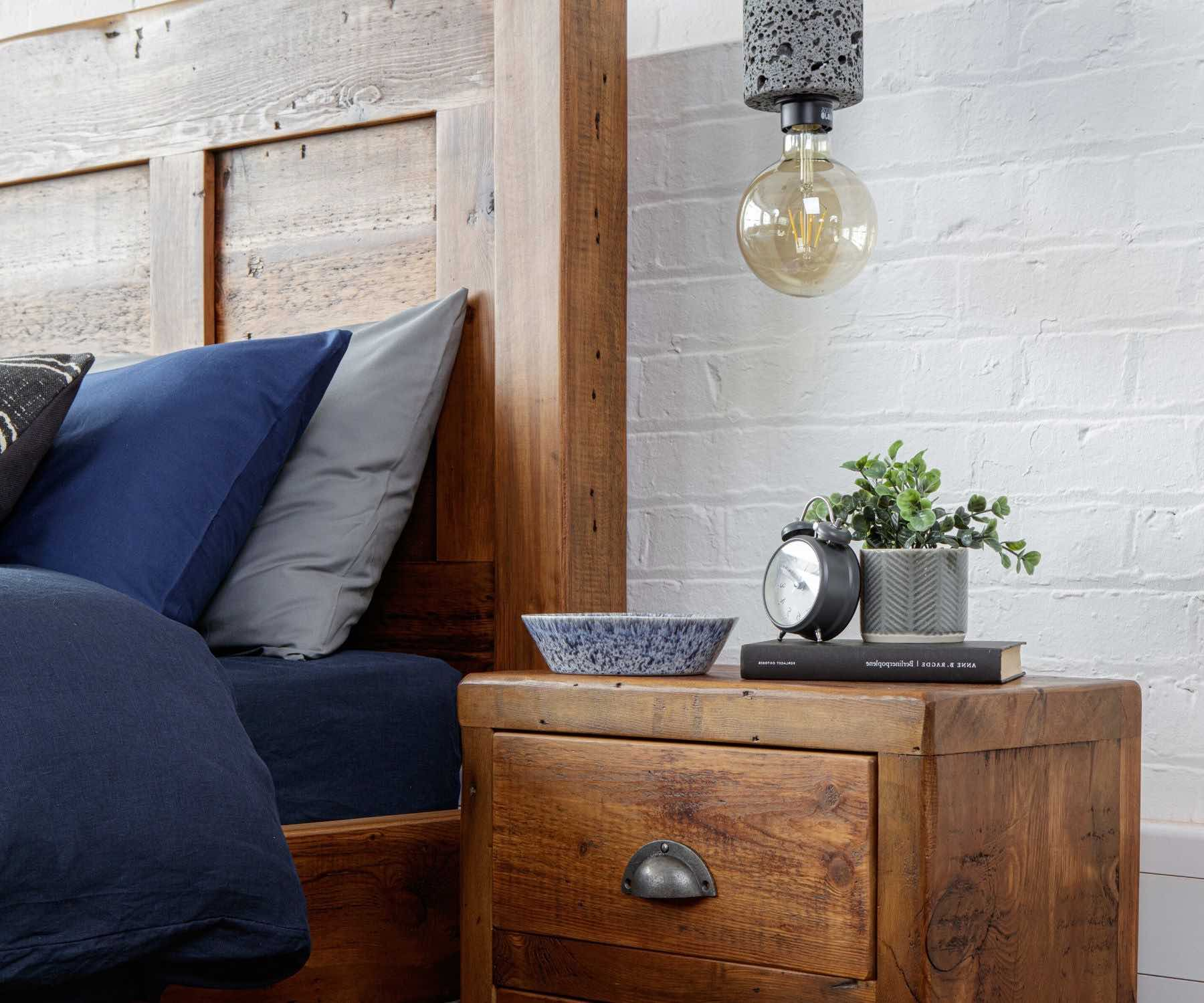 blue pillow cases used on reclaimed wood bed