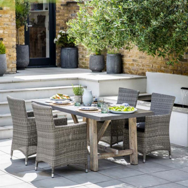 chilson dining table with rattan garden chairs
