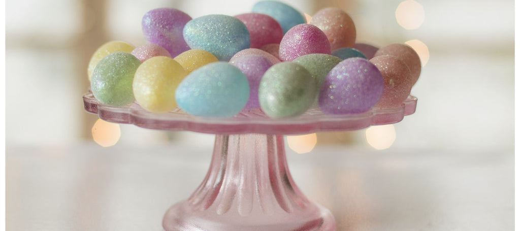 Multicoloured painted eggs on cake stand