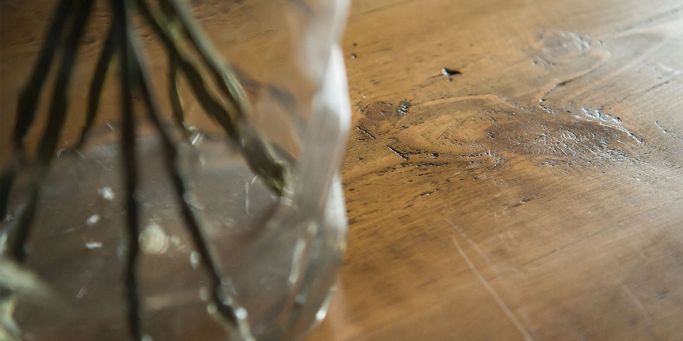 closeup of reclaimed wood dining table