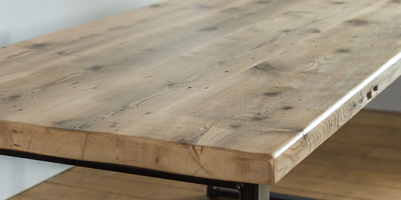 close up of medium reclaimed wood dining table