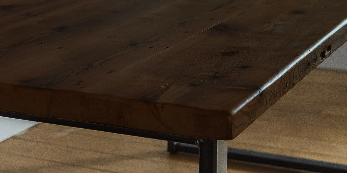 close up of dark reclaimed wood dining table
