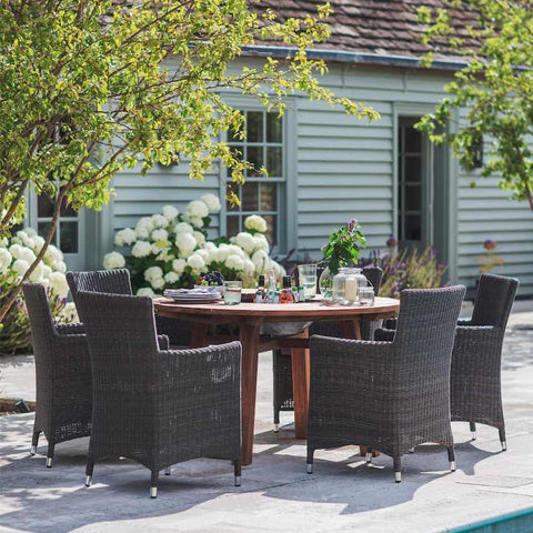 Round St Mawes Garden Table in Reclaimed Teak with rattan chairs