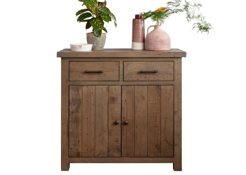 Cut out of medium reclaimed wood sideboard with plants and ornaments on top