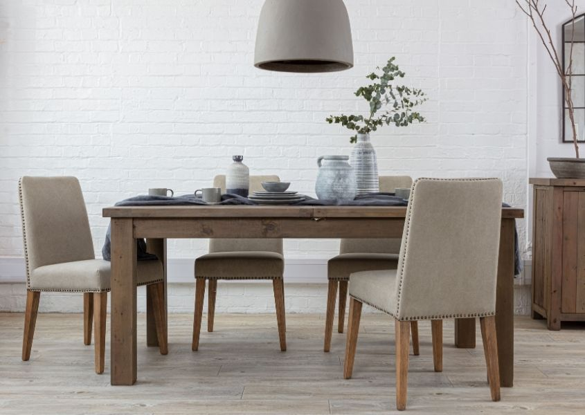 Reclaimed wood extendable dining table with fabric dining chairs with grey hanging ceiling light