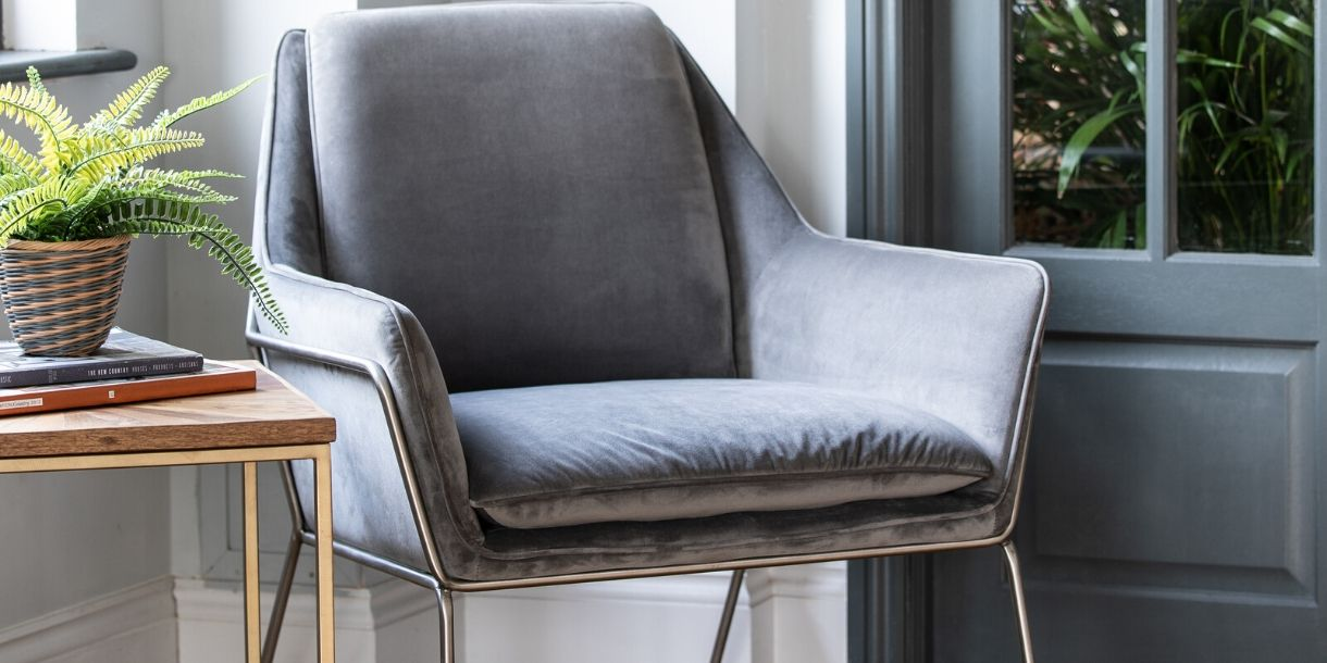 Finchley Grey Velvet Armchair in living room next to side table