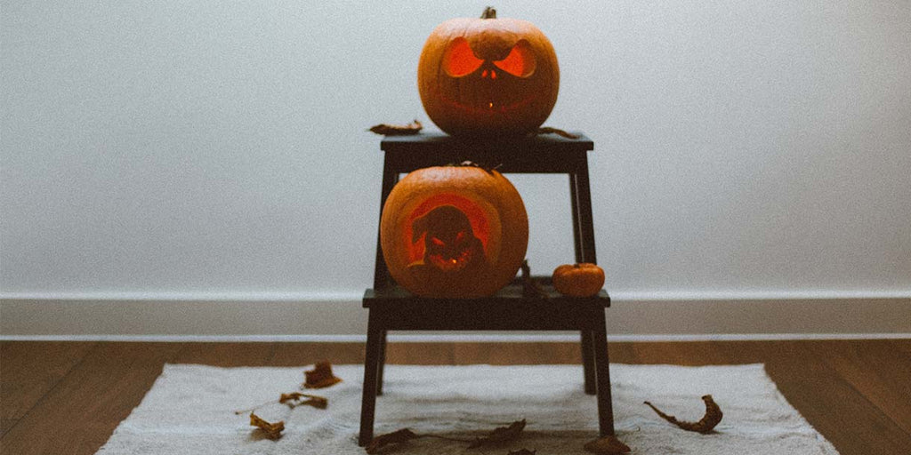 Two pumpkins on wooden chair