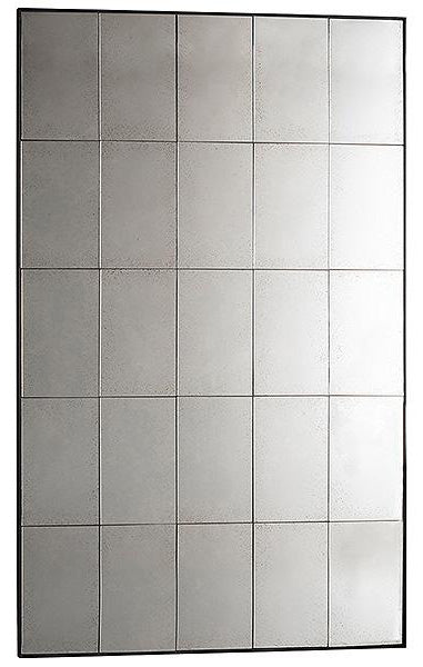 A floor mirror with a metal window glass design