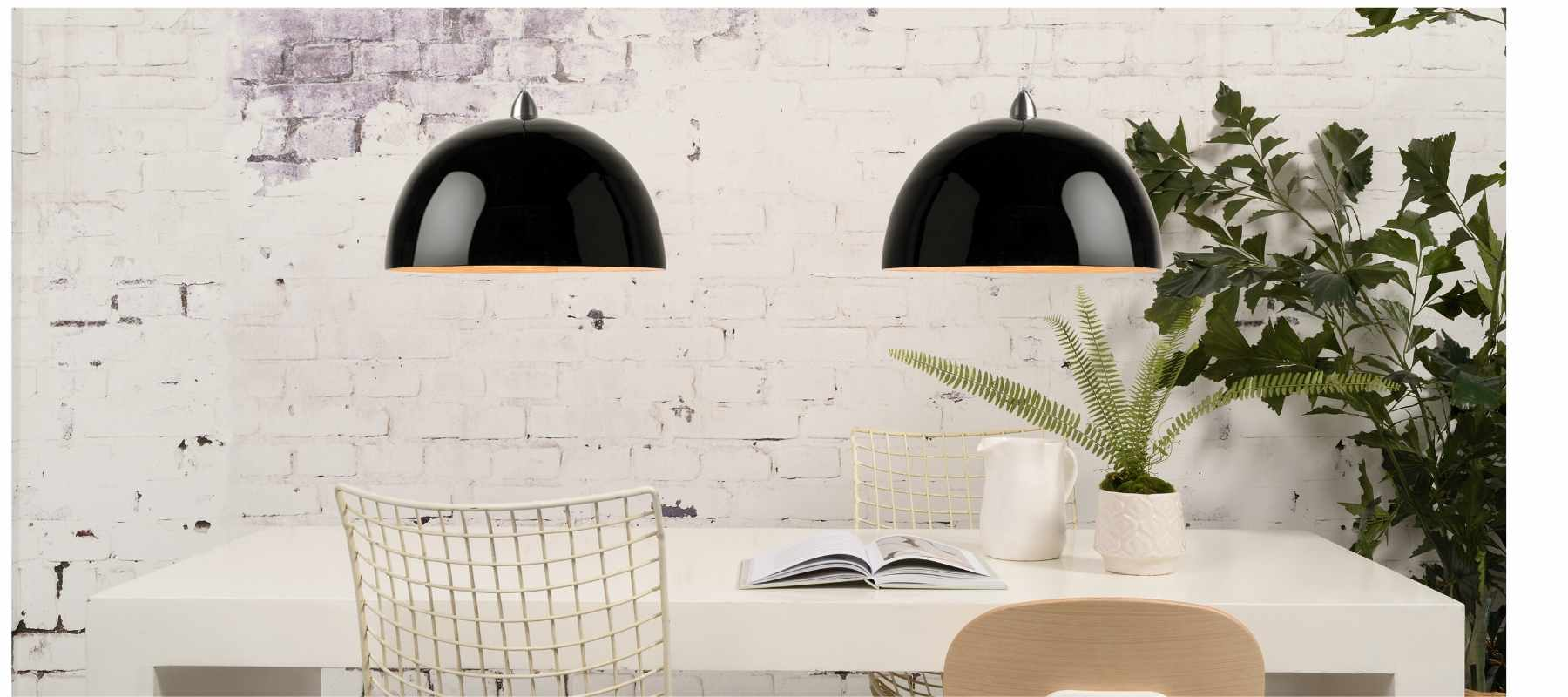 Black double pendant lighting with white exposed brick wall