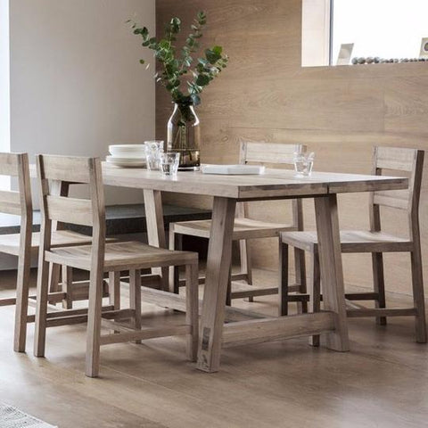 Oak dining table with matching oak dining chairs