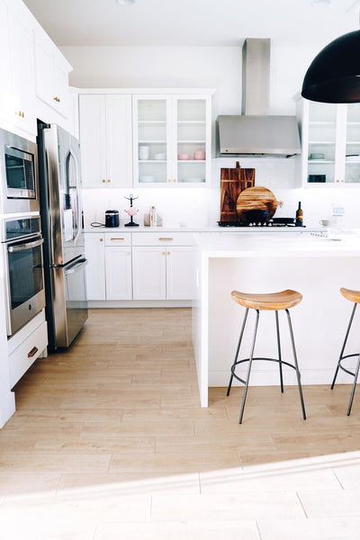 White kitchen with wooden stools