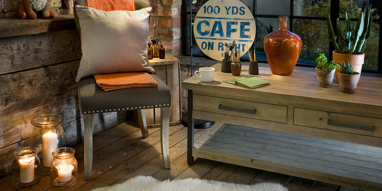 Rustic Wood Coffee Table and Grey Chair in Room
