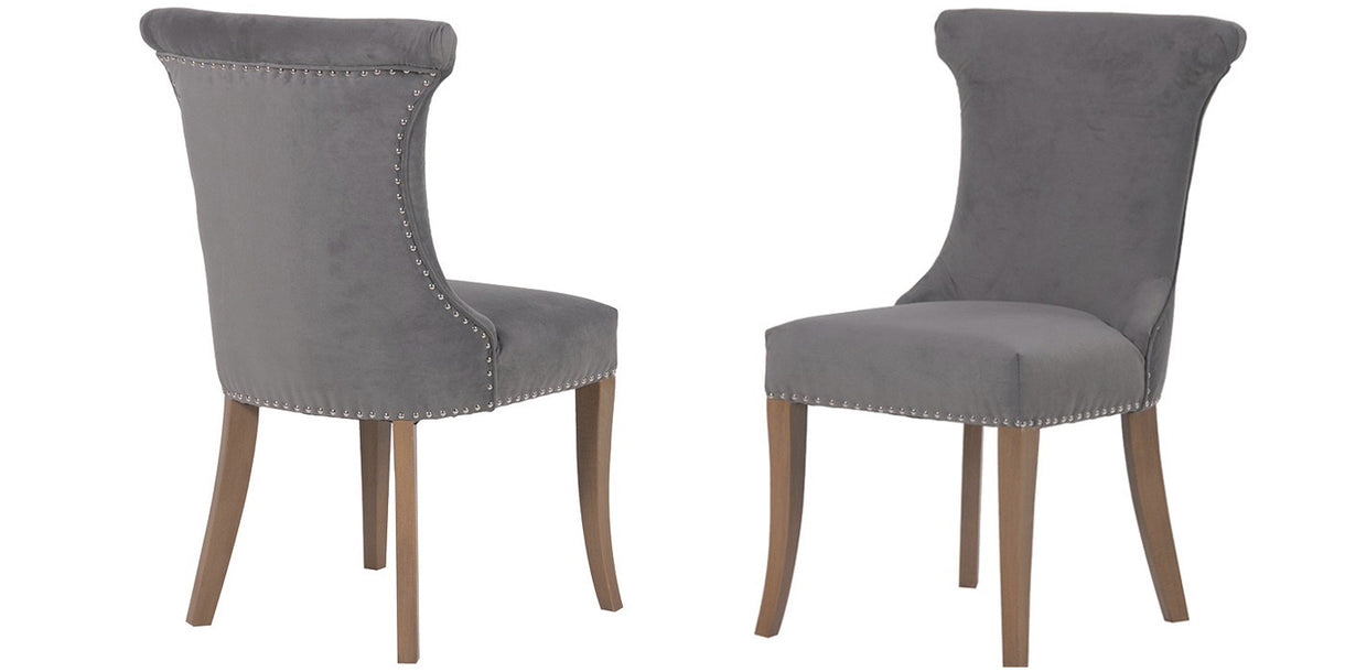 light grey fabric dining chairs with studs and wooden legs
