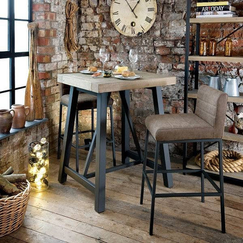 Industrial Lowry Reclaimed Wood Bar Table and stools in room