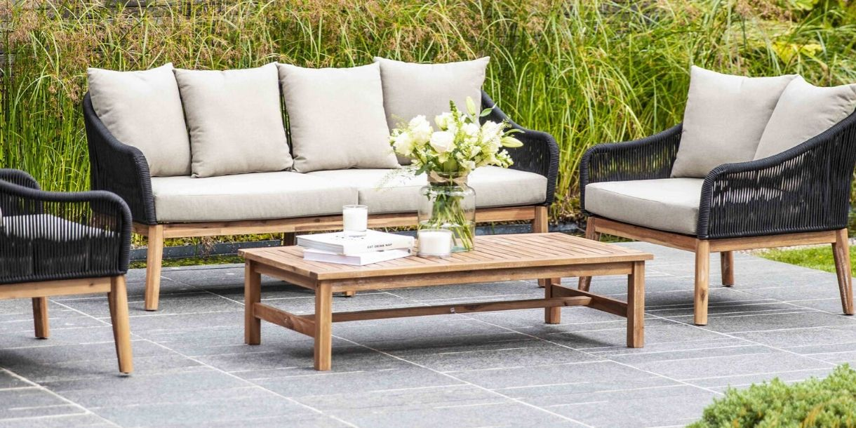 Luccombe Garden Sofa Set in garden with coffee table and armchairs