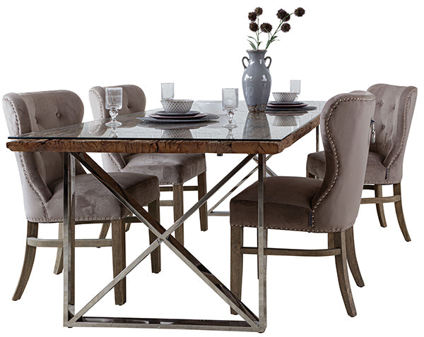 Four taupe velvet dining chairs around a luxurious dining table