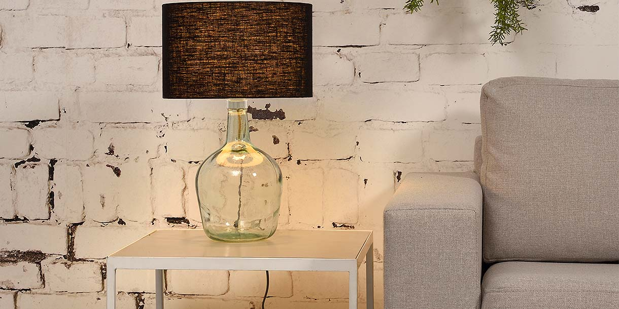 Mia Recycled Glass Table Lamp with black shade on side table