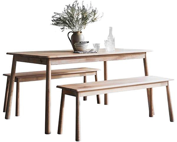 A Scandi style oak dining table with matching benches