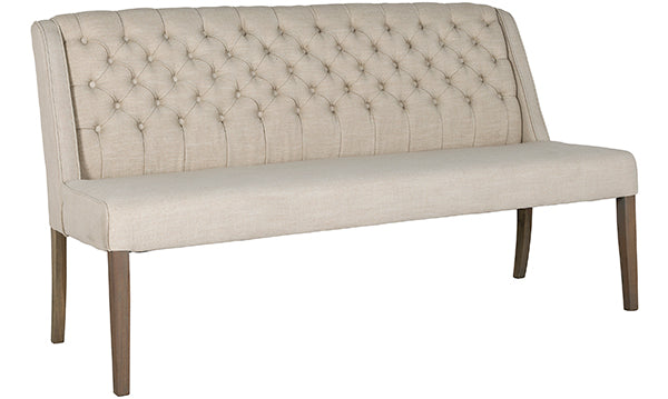 A large upholstered dining bench on wooden legs