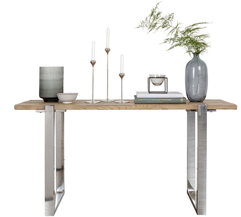 A reclaimed elm console table with candles and vases on top