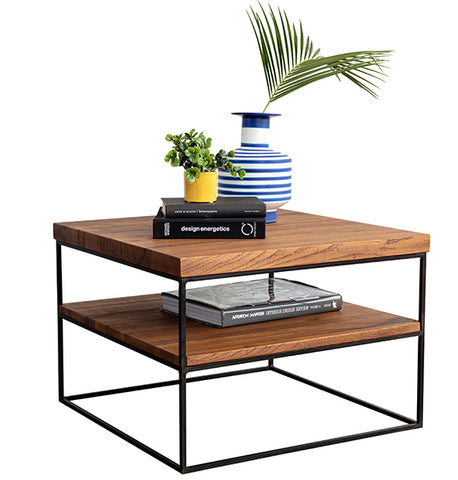 An Industrial style Oak Side Table with a plant and a vase on top