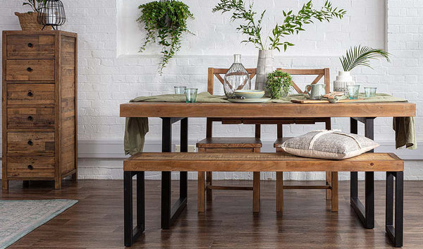 Standford Reclaimed Wood Dining Table with green plants on top
