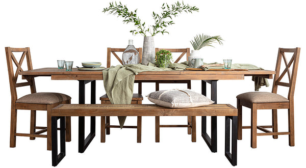 An industrial style reclaimed dining set with matching chairs and dining bench