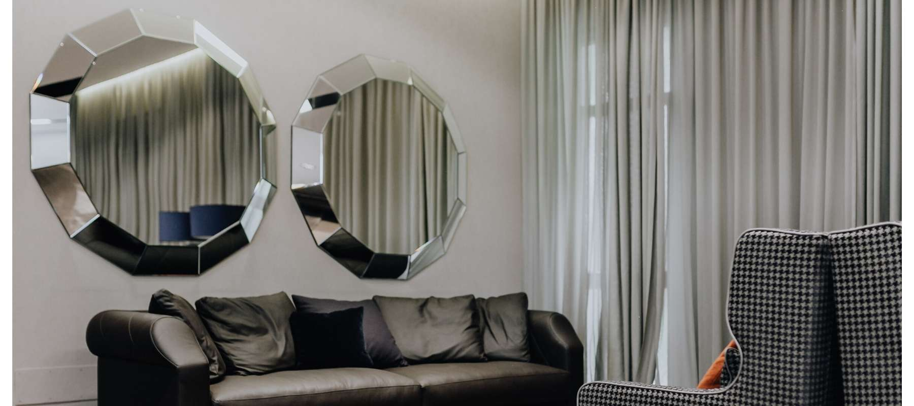 Two large hexagonal mirrors on living room wall