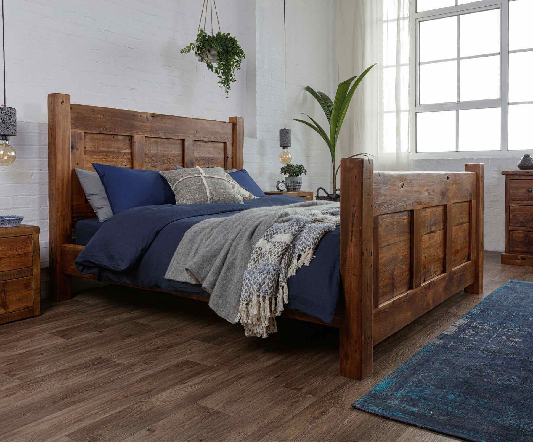 Large reclaimed wood bed with blue bedding