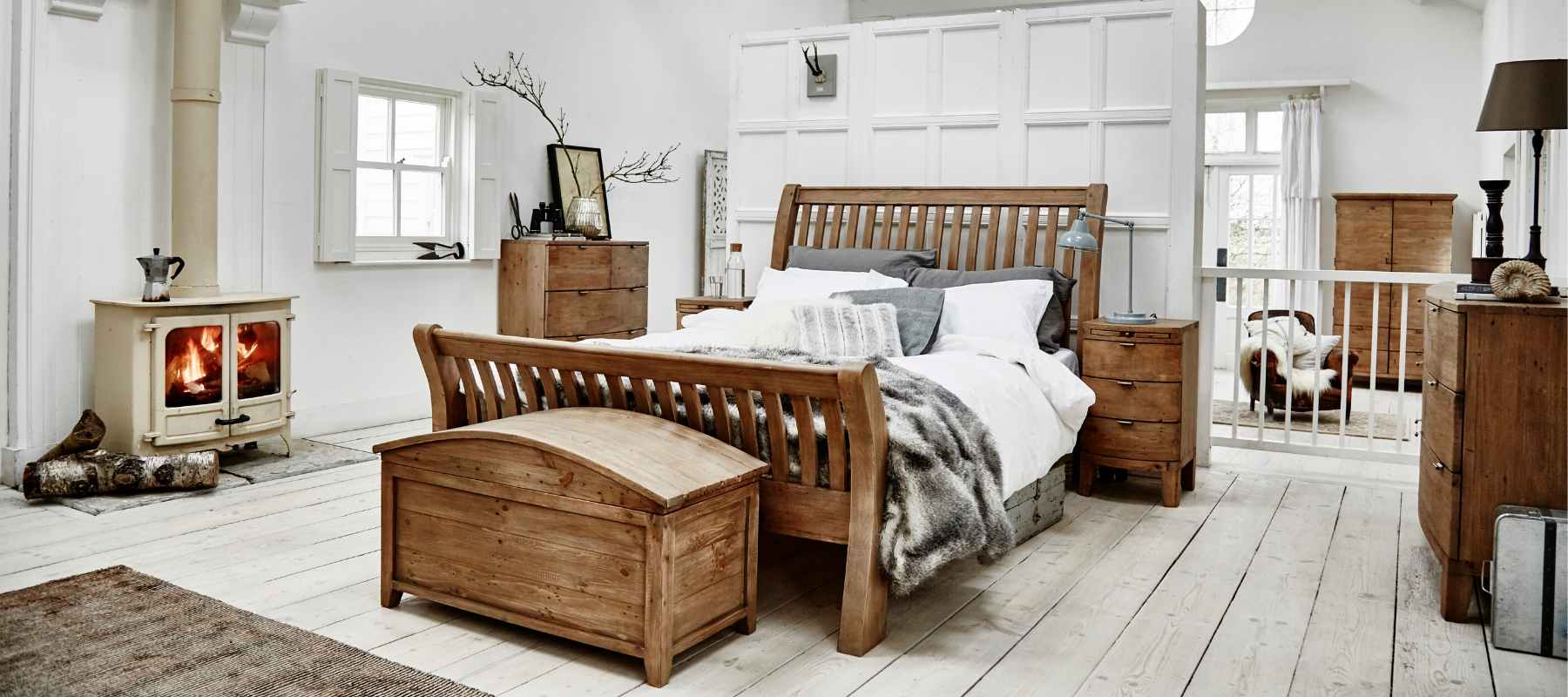 Rustic styled white bedroom including reclaimed wood bed, blanket box and chest of drawers