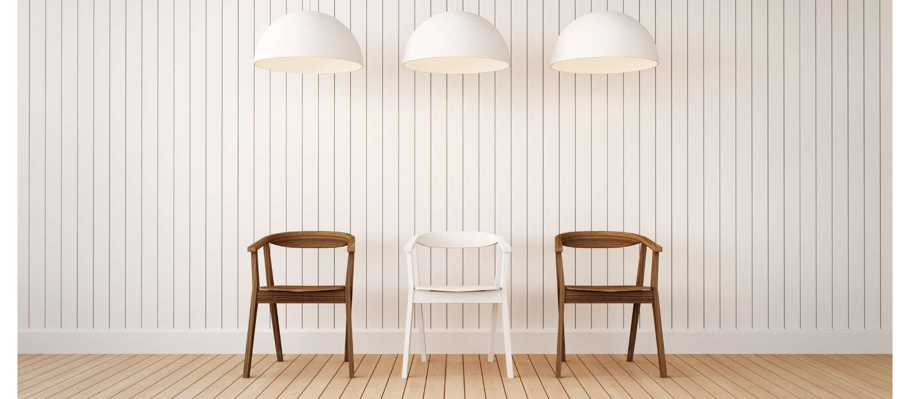 Wooden dining chairs with three white kitchen pendant lights