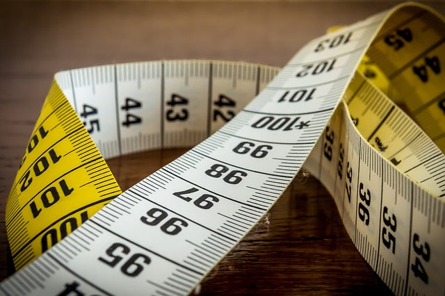 Tape Measure on Wooden Desk