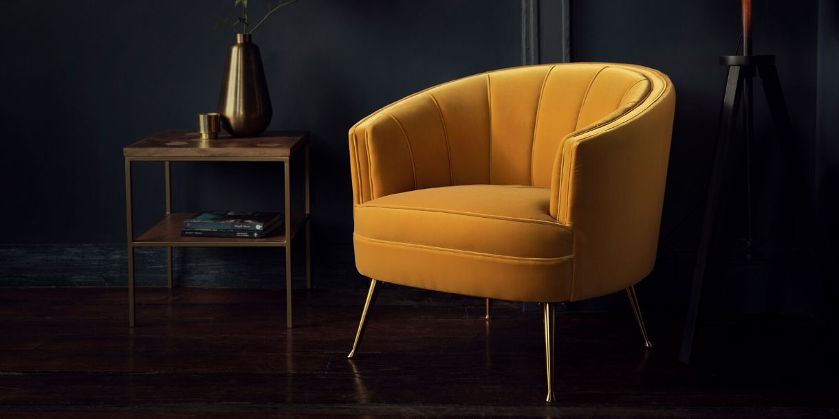 Yellow velvet armchair with gold coloured legs